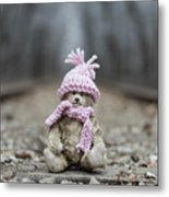 Little Teddy Bear Sitting In Knitted Scarf And Cap In The Winter Forest Between The Rails Metal Print