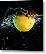 Orange Splashing In Water Metal Print