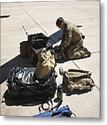 Pararescuemen Sorts Out His Gear Metal Print