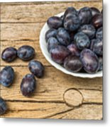 Plate Full Of Fresh Plums On A Wooden Background Metal Print