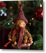 Silly Old Monkey Toy In A Child Hands Under The Christmas Tree Metal Print