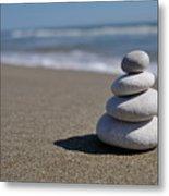Stack Of Pebbles On Beach Metal Print
