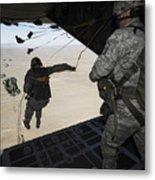 U.s. Airmen Jump From A C-130 Hercules Metal Print