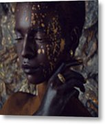 Woman In Splattered Golden Facial Paint Metal Print