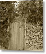 Wood Gate In A Wall Of Stones Metal Print