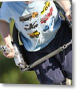 Young Boy Smiling Swinging In A Swing Metal Print