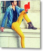 Young Man Reading Red Book, Sitting On Street Metal Print