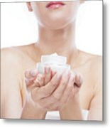 Young Woman Holding A Moisturizer Jar In Her Hands. Metal Print