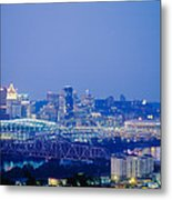 Buildings In A City Lit Up At Dusk Metal Print