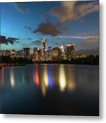 Clouds Roll Over The Austin Skyline As The Neon Reflects In The Glass-like Waters Of Lady Bird Lake Metal Print