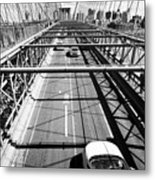 traffic vehicles driving over the worn tarmac on brooklyn bridge New York City USA Metal Print