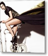 Young Woman In Long Dress On Exercise Bike Metal Print