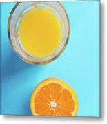 Glass Of Orange Juice And Half Of Orange Metal Print