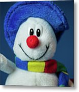 A Cute Little Soft Snowman With A Blue Hat And A Colorful Scarf Metal Print