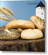 Different Breads And Windmill In The Background Metal Print by Deyan Georgiev