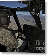 Pilot Operating The Cockpit Of A Uh-60 Metal Print