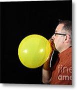 Man Inflating Balloon Metal Print