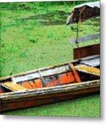 A Boat On Amazon Green Water Metal Print