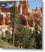 A Couple Hikes Along A Trail In Bryce Metal Print