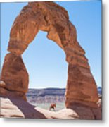 A Couple Kissing Under Delicate Arch In  The Arches National Par Metal Print