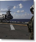 A Crew Chief Watches A Ch-46e Sea Metal Print