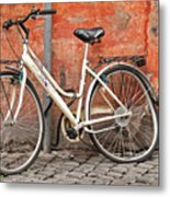 A Dejected Bicycle Waits Patiently On A Cobbled Street In Rome. Metal Print