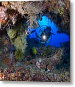 A Diver Peers Through A Coral Encrusted Metal Print