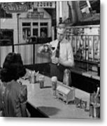 A Druggist Prepares Ice Cream Floats At A Soda Fountain Metal Print