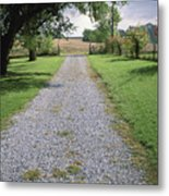 A Gravel Road Marks The Entranceexit Metal Print