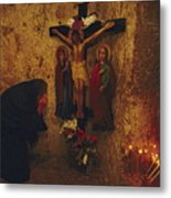 A Greek Pilgrim Prays In The Grotto Metal Print by Annie Griffiths