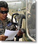 A Honduran Crew Chief Consults Metal Print