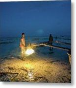 A Local Fisherman Uses Flame To Repair His Boat At Sunset Metal Print