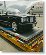 A Luxury Bentley Unloaded From An Metal Print by Justin Guariglia