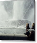 A Man Relaxes At A Fountain Metal Print by Stacy Gold
