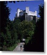 A Man Walks Toward The Salzburg Castle Metal Print by Taylor S. Kennedy