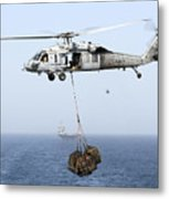 A Mh-60 Helicopter Transfers Cargo Metal Print
