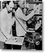 A Pharmacist Demonstrates The Use Of An Metal Print