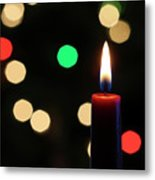 A Red Christmas Candle With Blurred Lights Metal Print