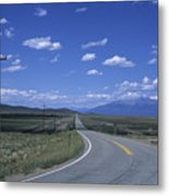 A Road Disappears Into The Distance Metal Print