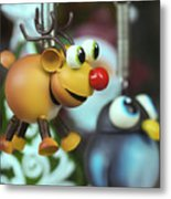A Rudolph The Red Nosed Reindeer Ornament With A Penguin Metal Print
