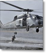 A Search And Rescue Swimmer Jumps Metal Print