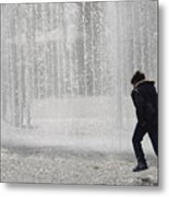 A Silhouette Of The Boy Against A Fountain Metal Print