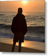 A Silhouetted Figure Enjoys The Ocean Metal Print