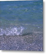 A Small Wave Ripples Onto Shore Metal Print