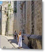 A Stroll By The Cathedral Metal Print