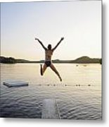 A Swimmer Jumps Off A Diving Board Metal Print