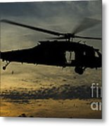 A U.s. Army Uh-60 Black Hawk Leaves Metal Print