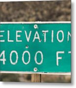 A Weathered Elevation Sign On Highway Metal Print