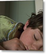 A Young Boy Sleeps In Green Pajamas Metal Print