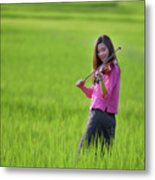 A Young Girl In A Folk Costume Plays A Vivaro In A Green Rice Fi Metal Print